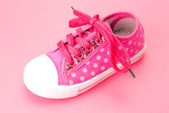 Toddlers pink baby shoes Stock Photos