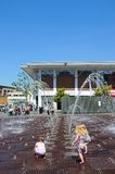 Toddlers playing in fountain, Liverpool. Toddlers playing in the fountains in Williamson Square enjoying the Summer sunshine, Liverpool, Merseyside, England, UK royalty free stock image