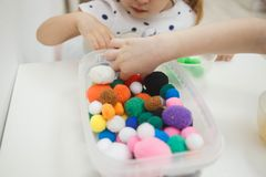 Toddlers playing multicolored educational games, mosaic and puzzles table.  royalty free stock image