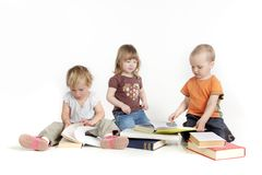Toddlers reading books Royalty Free Stock Image