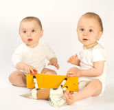 Toddlers and rocking horse Stock Photo