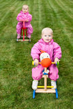 Toddlers on rocking horses Royalty Free Stock Image