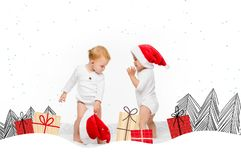 Toddlers with santa hats royalty free stock images