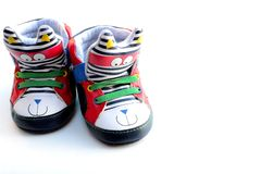 Toddlers shoes. Funky toddlers shoes on isolated white background Royalty Free Stock Photography