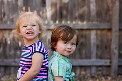 Toddlers Sitting Back to Back Royalty Free Stock Photo