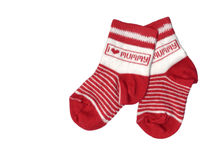Toddlers socks isolated. Pair of red toddlers socks isolated over white Royalty Free Stock Image