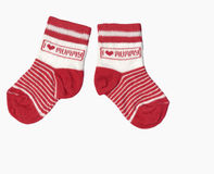 Toddlers socks isolated. Pair of red toddlers socks isolated over white Stock Photo