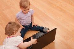 Toddlers studying laptop Royalty Free Stock Image