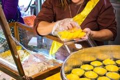 Toddy palm cake Kanom Tarn Thai dessert in the market stock photo
