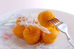 Toddy palm cake topped with coconut on the utensils. Stock Photography