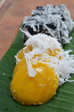 Toddy palm cake topping slice coconut on banana leaf Stock Photos