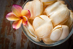 Toddy palm in glass bowl on wooden table. Royalty Free Stock Image