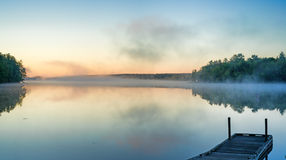 Toddy Pond, Maine with mist and wharf Royalty Free Stock Photo