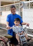 A todler on bicycle in Bangkok,  Thailand Stock Photography