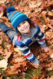 Todler is smiling in the autumn stock photos