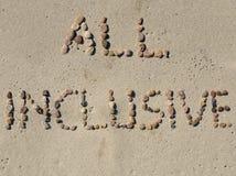 Todo el texto inclusivo en la arena de la playa Fotos de archivo libres de regalías