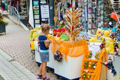 TODTMOOS, GERMANY - JULY 22 2018: Child looking at the many souvenirs for sale in the German village of Todtmoos royalty free stock photos