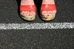 Toe the Party Line. Woman 'Toes the Party Line Royalty Free Stock Image