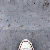 Toe of shoe on concrete Royalty Free Stock Photo