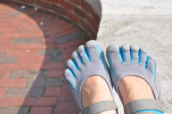 Toe Shoes. A pair of blue and grey toe shoes on someone's feet Stock Images