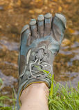 Toe Shoes. Toe shoe on left foot on grassy bank of creek Stock Photography
