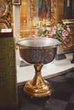 Toebehoren voor doopsel het baden in de doopdoopvont Stock Fotografie