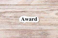 Toekenning van het woord op papier Concept Woorden van Toekenning op een houten achtergrond Royalty-vrije Stock Fotografie