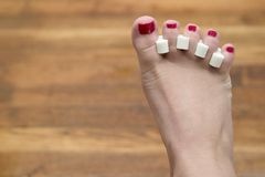 Toenails. Red painted toenails royalty free stock photography