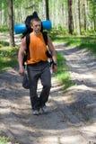 Toerist bij hout stock foto's