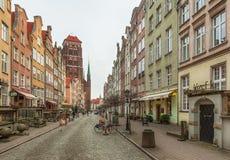 Toeristen en plaatselijke bewoners die op straten in historisch centrum van G lopen royalty-vrije stock afbeelding