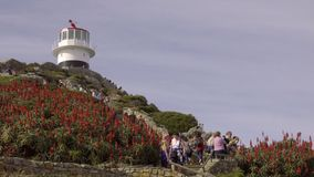 Toeristen vist de Kaap van Goede Hoopvuurtoren stock videobeelden