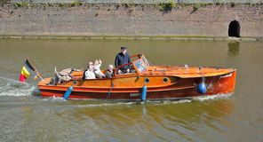 Toerists taking a boat-tour in gent Stock Photo