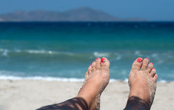 Toes on the beach. Womans feet covered with sand on the beach in sunshine Stock Photo
