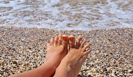 Toes on the coastline Royalty Free Stock Image