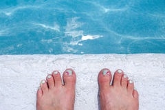Toes at the Edge of the Pool Stock Images