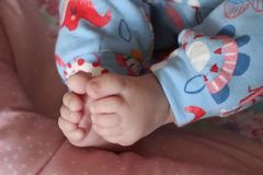 Bare baby feet cute soft and snuggley stock image