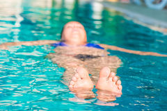 Toes peeking out of the water. In the pool Stock Images