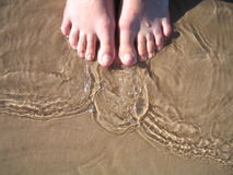 Toes in the water. Waves Royalty Free Stock Images