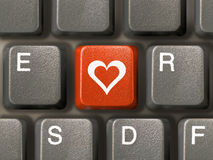 Toetsenbord (close-up), rode sleutel met hart Royalty-vrije Stock Fotografie