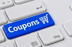 Toetsenbord met een blauwe knoop - Coupons Royalty-vrije Stock Foto's