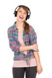 Toevallig meisje dat hoofdtelefoons draagt royalty-vrije stock afbeeldingen
