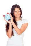 Toevallig meisje met een spaarvarken Royalty-vrije Stock Foto's