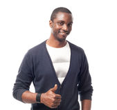 Toevallige geklede Afro-Amerikaanse mens met witte omhoog t-shirt en duimen Stock Fotografie