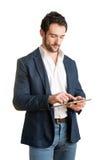 Toevallige Zakenman Looking bij een Tablet stock afbeelding