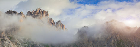 Tofane mountain range at foggy morning. Panorama from Falzarego Royalty Free Stock Images