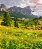 Tofane mountain range at sunny foggy morning Stock Image