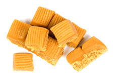 Toffee. Several toffee in plate on white background royalty free stock image