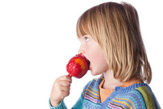 Toffee apple child eating sweets Stock Photography