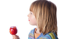 Toffee apple child eating sweets Stock Photos