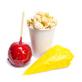 Toffee apple, sugared almonds, popcorn Royalty Free Stock Photo
